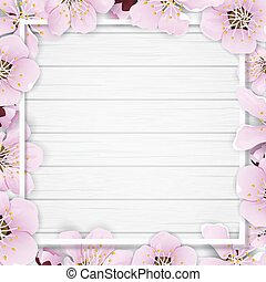 Spring frame with flowers on wooden background.