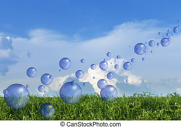 Spring fresh bubbles over green meadow against blue sky