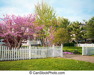 Spring blossoms and a white picket fence surround this home in Central New Jersey.