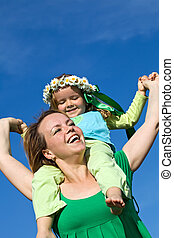 Woman and little girl having fun outdoors in spring time