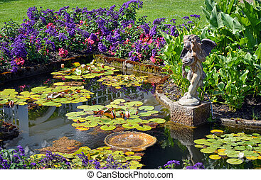 Spring garden pond - Colorful spring garden pond with cherub...