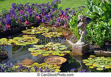 Spring garden pond - Colorful spring garden pond with cherub...