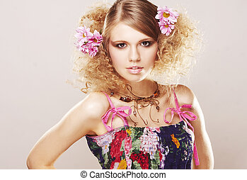 girl with flowers in beautiful dress on white background