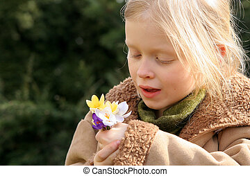 Spring girl  - Little girl and a bunch of crocuses