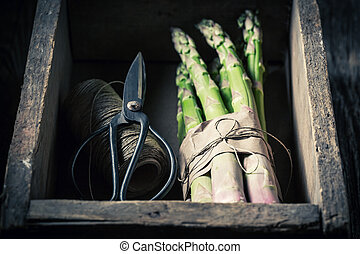 Spring green asparagus in a wooden box