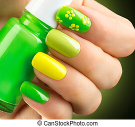 Spring green manicure. Bottle of nail polish