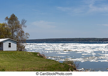 Spring Ice Thaw with Copy Space - Ice breaking up on a bay ...