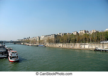 Spring in Paris, the seine river with cruise boats, vibrant...