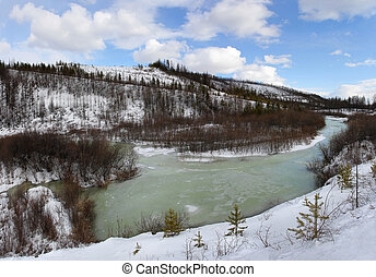 Spring in Southern Yakutia - melting river on a background ...