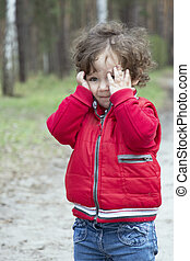 Spring in the forest distressed little girl.