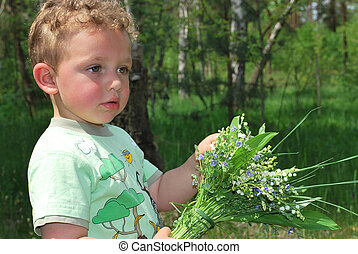 boy with a bouquet of lilies of the valley