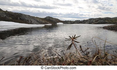 Spring in the mountains. Beautiful landscape - melt pond...