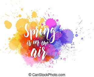 Spring is in the air - inspirational handwritten modern calligraphy message on watercolor paint splash