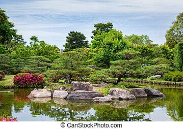 Spring japanese garden with lake