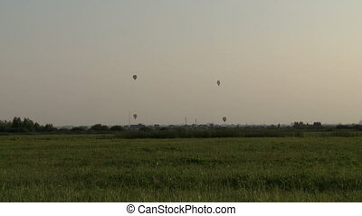 Spring landscape. View of air balloons over field