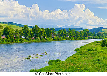 Spring landscape with Tatra Mountains over The Dunajec River.