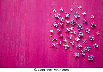 spring lilac flowers and grass on wooden background