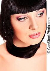 spring makeup - Beautiful brunette woman posing at studio....