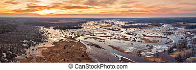 Spring melting river flood panorama. Sunset over meadows