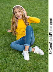 spring mood playlist. happy little girl listen favorite song. kid beauty fashion. teen girl listen music. sounds of nature. relax on green grass. spring leisure time. happy childhood. kid in headset