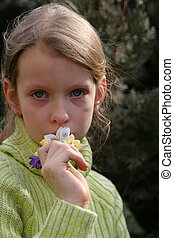 Spring mood - Young grying girl with a bunch of crocuses