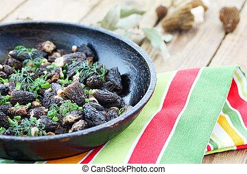 spring mushrooms in a frying pan