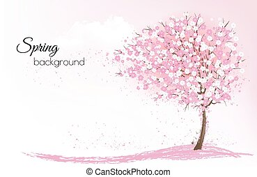 Spring nature background with a pink blooming sakura tree. ...