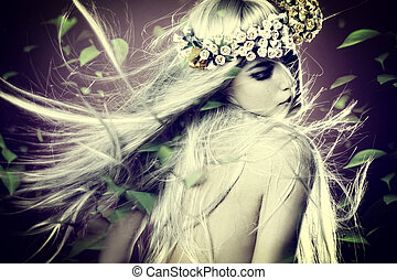 spring nymph with long blond hair in motion and wreath of...