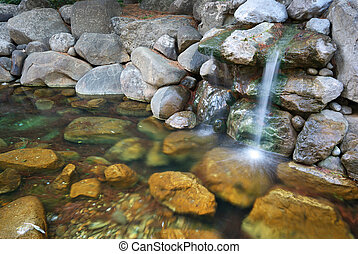 Spring of water from rock. Nature composition.