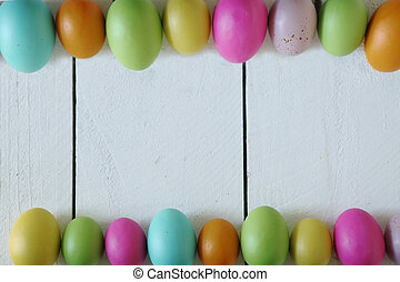 Spring or Easter Themed Background of Old Wood and Colored Eggs Lined Up