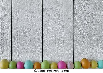 Spring or Easter Themed Background of Old Wood and Colored...