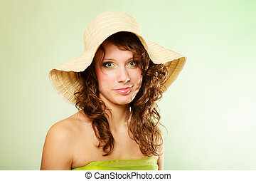 Spring or summer. Young woman girl in hat and green dress