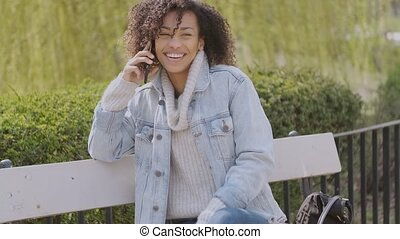 Spring or sunny Autumn outdoor portrait of beautiful mixed race young woman