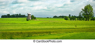 Spring panorama with old windmill