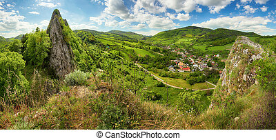 Spring panorama with village and mountain