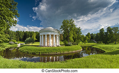Spring park with classical building and bridge