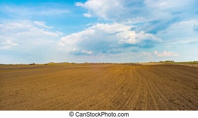 spring plowed field, panoramic time