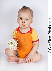 spring portrait boy with bouquet of flowers. Child with white snowdrops. studio portrait.