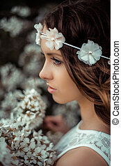 Spring - pretty woman with flower hair band in front of a...