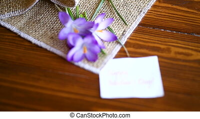 spring purple little crocus flowers on a wooden table