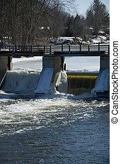 Spring River Thaw - River thawing and flowing through a dam