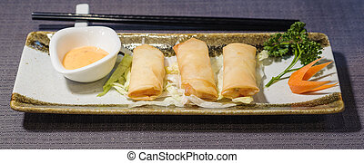 Spring Roll with sweet and sour sauce, chinese typical food
