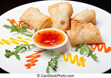 Spring Rolls with sauce on the plate