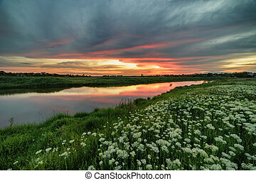 Spring sunset by the river