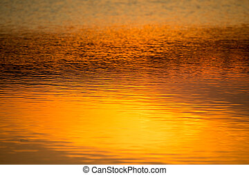 spring sunset reflecting in water