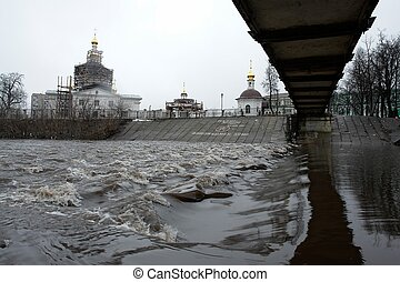 Spring tide. Orthodox church. Wiew from under the bridge.