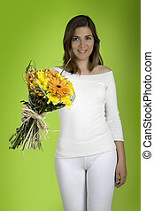 Spring time - Beautiful woman with flowers on a green ...