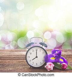 Spring time concept - retro alarm clock with spring fresh ...