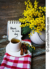 spring time - Glass cup with tea and blooming yellow mimosa ...