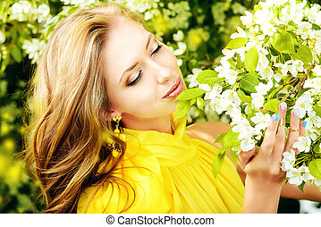 spring time - Romantic young woman in the spring garden ...